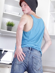 Skinny redhead twink Elijah Young jerks off in kitchen.